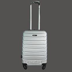 Чемодан пластиковый на 4х колесах мини XS серебряный   20х51х35 см   2.400 кг   27 л   FLY 1107
