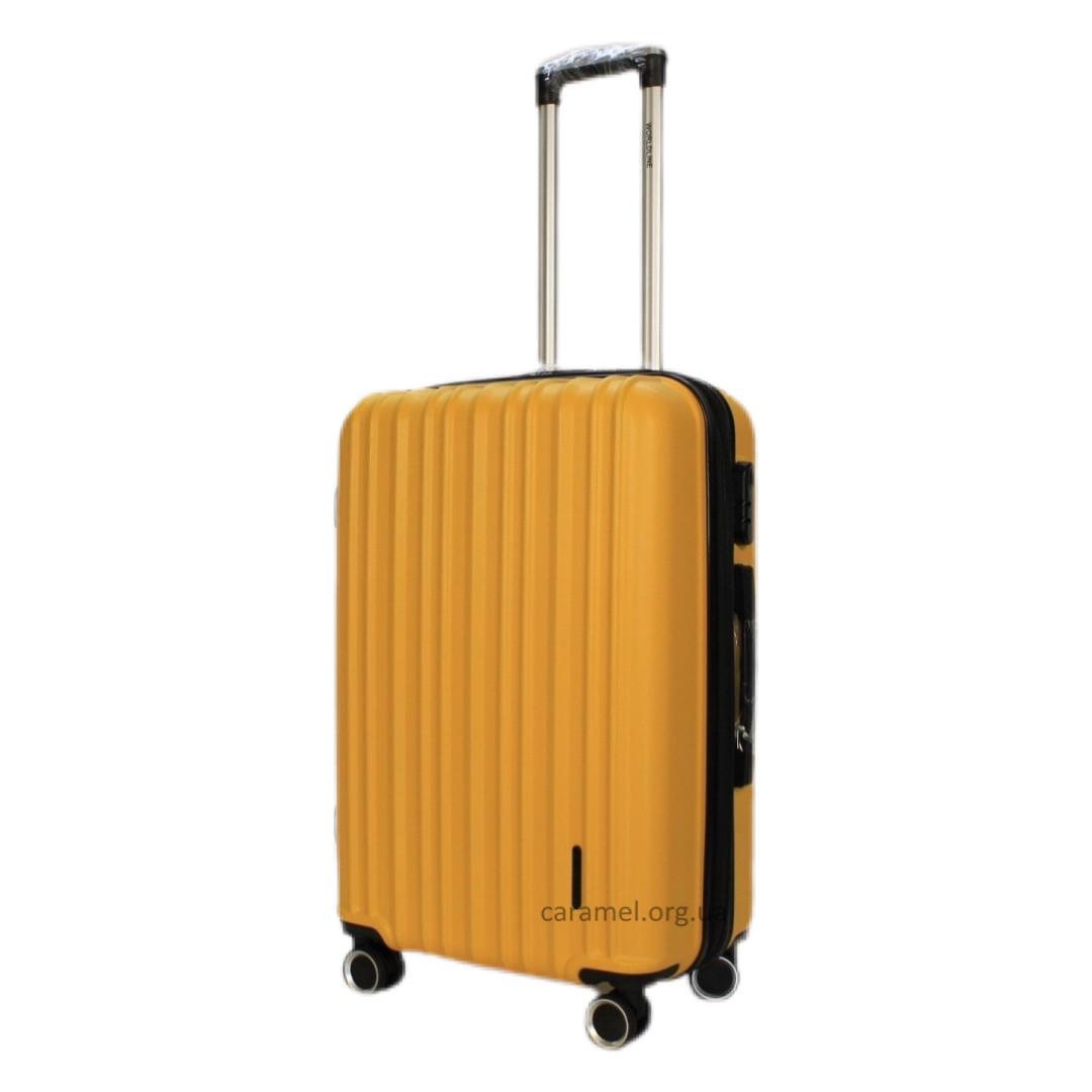 Чемодан поликарбон 4 колеса M 66 x 42 x 26 + 5 cm 3,4 kg 70  623 желтый средний