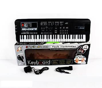 Синтезатор для дитини з мікрофоном і регулюванням звуку Дитячий синтезатор працює від мережі 61 клавіша