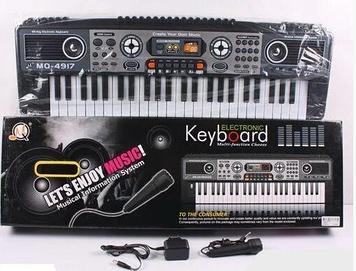Дитяче піаніно з мікрофоном працює від мережі і батарейок Іграшкова музичне піаніно Дитячий синтезатор