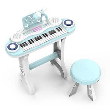 Піаніно-синтезатор на ніжках зі стільчиком і мікрофоном для дитини Дитяче піаніно працює від батарейок