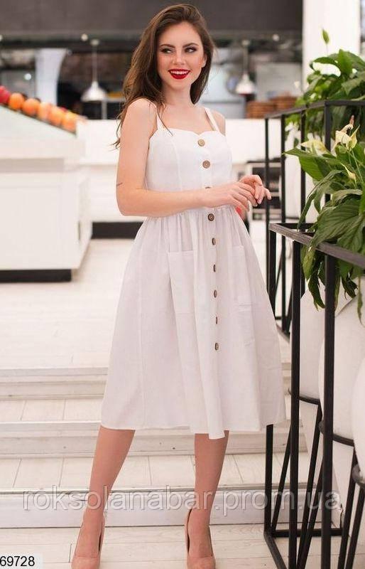 Літнє жіноча сукня білого кольору з гудзиками