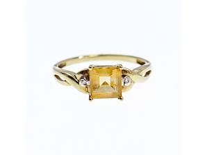 Золотое кольцо с желтым турмалином и бриллиантами