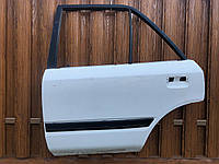 Дверь задняя левая Mazda 323 BG седан 1989 - 1994 гв., фото 1