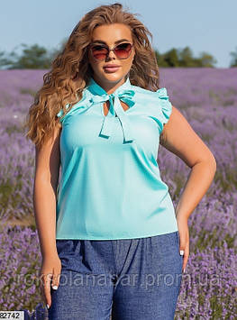 Жіноча блузка XL ментолового кольору в білий горошок