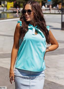 Жіноча блузка ментолового кольору в білий горошок