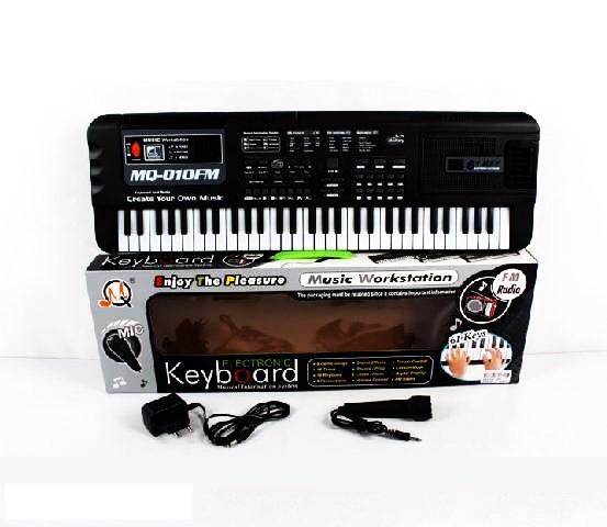Синтезатор для дитини MQ-010FM з мікрофоном, регулюванням звуку, працює від мережі (61 клавіша)