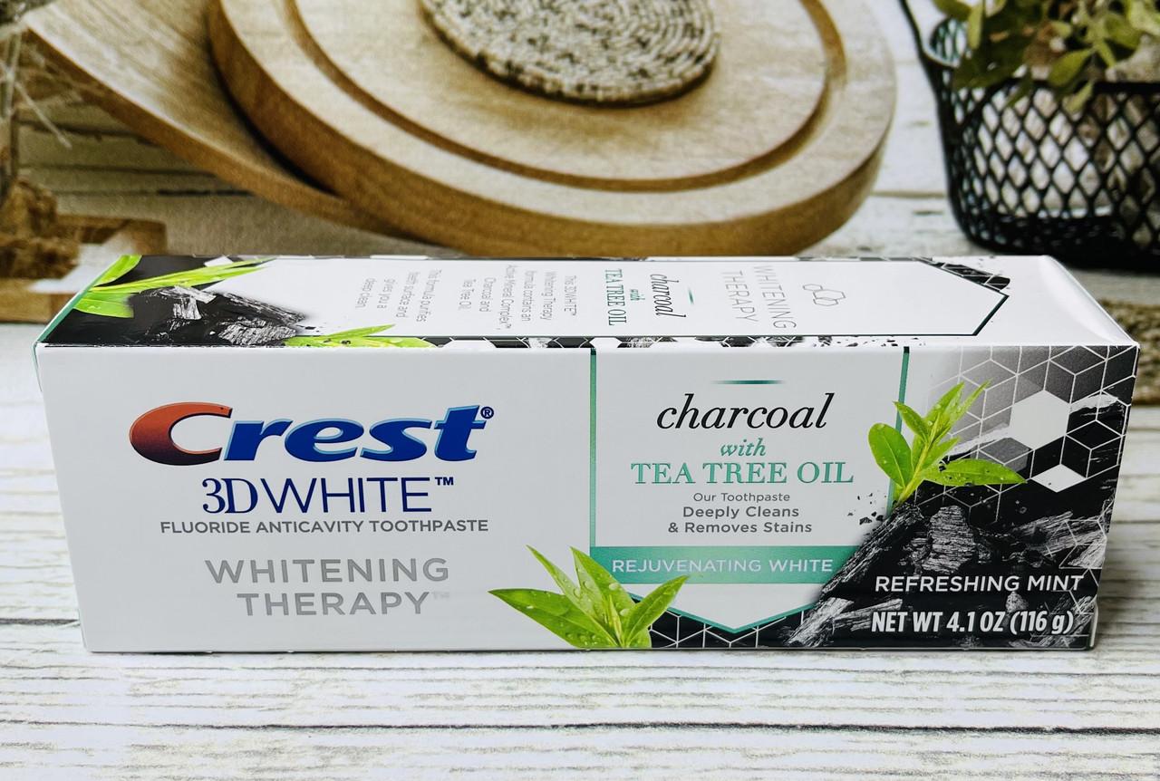 Отбеливающая зубная паста уголь с маслом чайного дерева Crest 3D White