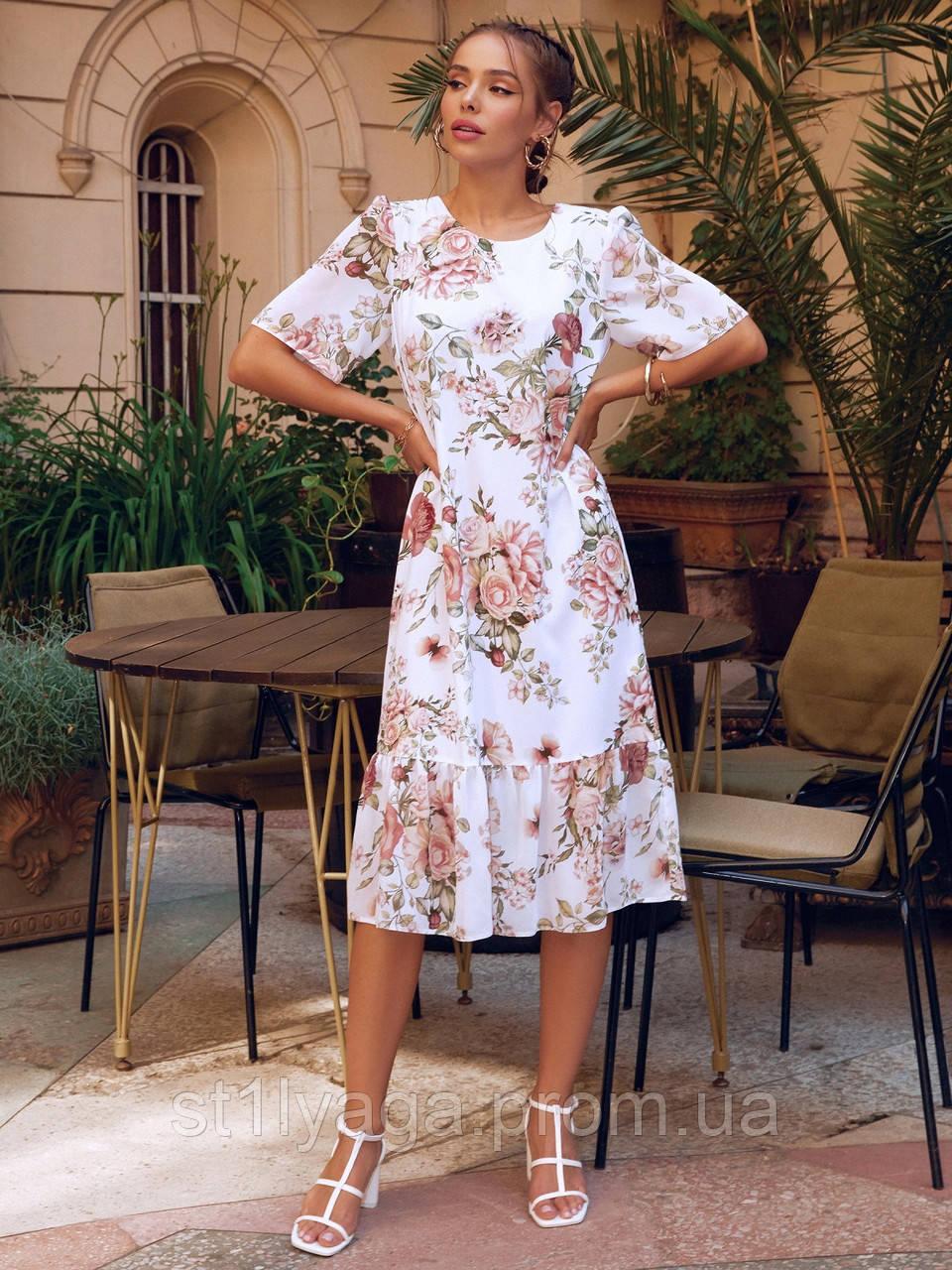Сукня-трапеція міді в квітковому принті з коротким рукавом
