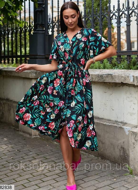 Літня синя сукня з тропічним принтом
