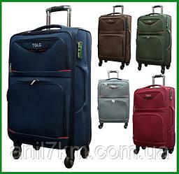 Большой дорожный чемодан на четырёх колёсах