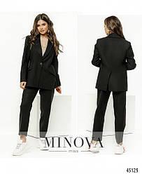 Стильный костюм-двойка с однобортным жакетом и классическими брюками размер :42-44,46-48,50-52,