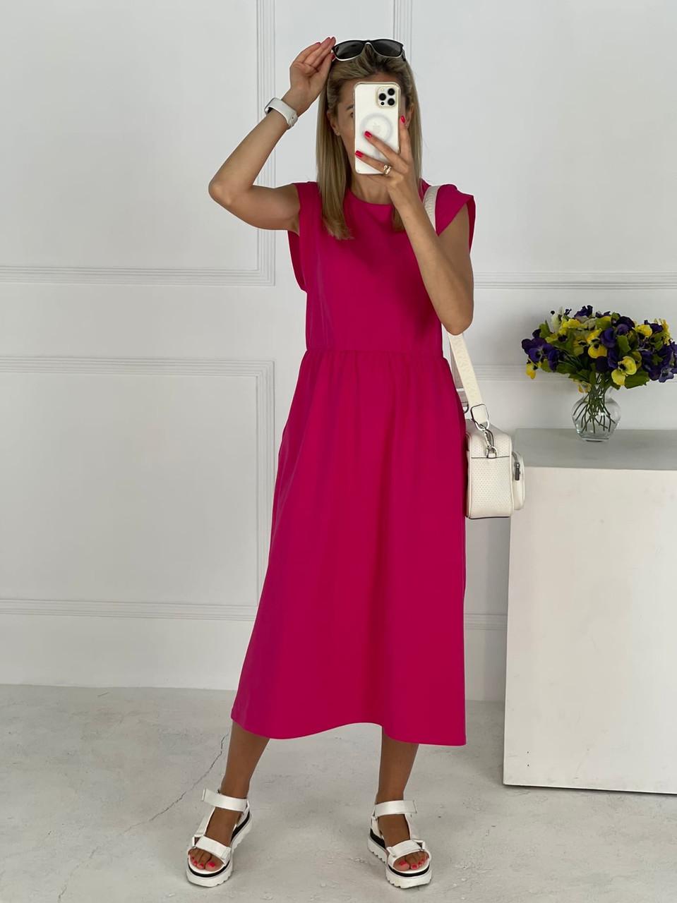 Плаття завдовжки міді з резинкою на талії, кишені в бічних швах