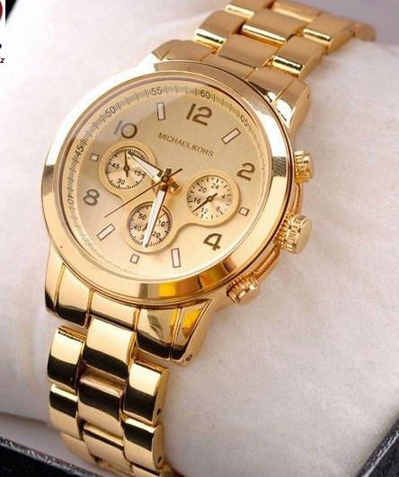 Годинник michael kors на руці