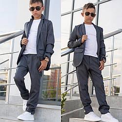 Костюм школьный классика пиджак+брюки для мальчика на одну кнопку серый 116-146.