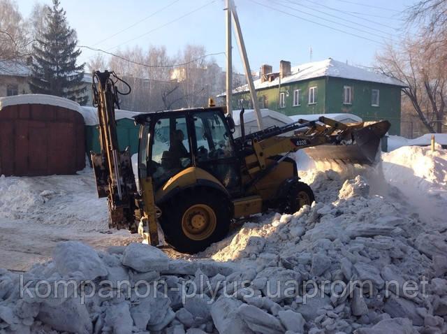 Услуги уборки снега экскаватором-погрузчиком в Киеве