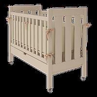 Детская кроватка Oscar на колесиках с выдвижным ящиком