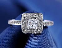 Серебряное кольцо с камнями циркона