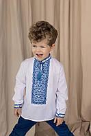 Вышитая сорочка для мальчика с оригинальным геометрическим орнаментом синего цвета