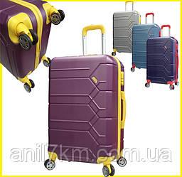 Большой  чемодан на восьми колёсах