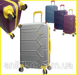 Средний пластиковый чемодан на восьми колёсах