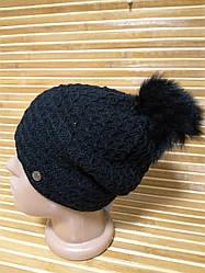 Женская вязаная шапка с мехом