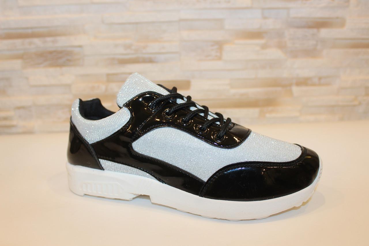 Кроссовки черные с серебристыми вставками Т547
