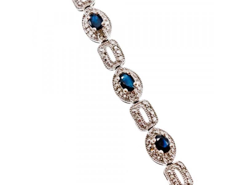 Серебряный браслет 925 пробы с темно-синим и бесцветным Сапфиром