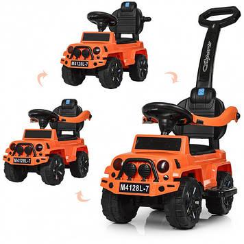 Машинка каталка-толокар с защитным бампером Толокар ребенку с ручкой для родителей и багажником оранжевый