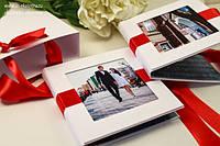 Фотоальбомы, фоторамки, подарочные пакеты, сувениры