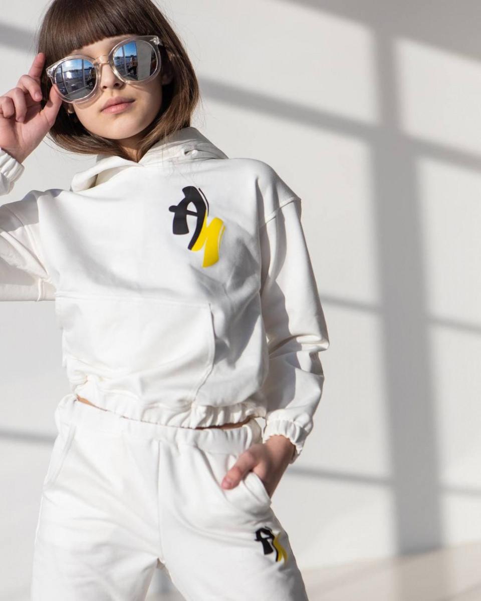 Дитячий спортивний костюм для дівчинки жовтий оптом А4
