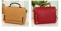 Женская сумка формы саквояж из качественного кожзаменителя