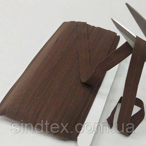 003 Трикотажная окантовочная бейка (эластичная, стрейч) 1,5см х 46м коричневая (СИНДТЕКС-1267)
