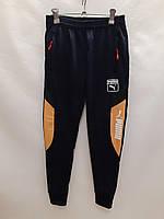 Подростковые спортивные штаны для мальчика на манжетах Puma 11-15 лет, темно-синие с желтым