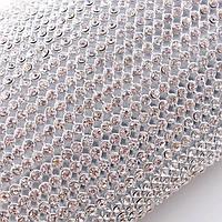 Стразовая термоткань Стразы Crystal в алюминиевом ложе.Цена за отрезок 1*45