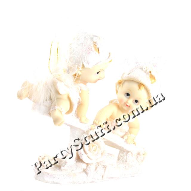 статуэтки ангелов на качели