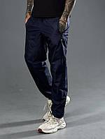 Штани чоловічі спортивні з плащової тканини темно-синій