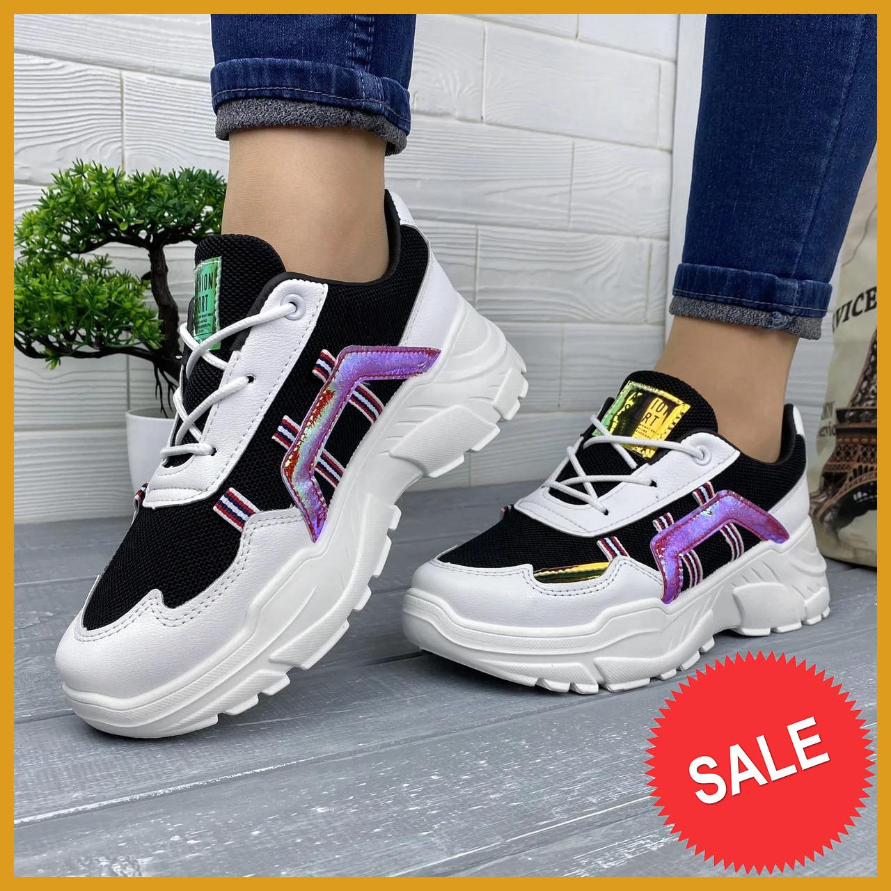 Модні жіночі чорно-білі кросівки