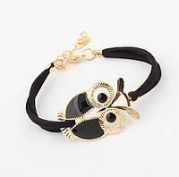 Браслет на кожаном шнурке с фигуркой Совы черного цвета, застежка/цепочка золотистого цвета