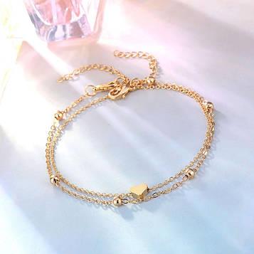 Набір жіночих золотих браслетів на ногу код 2118