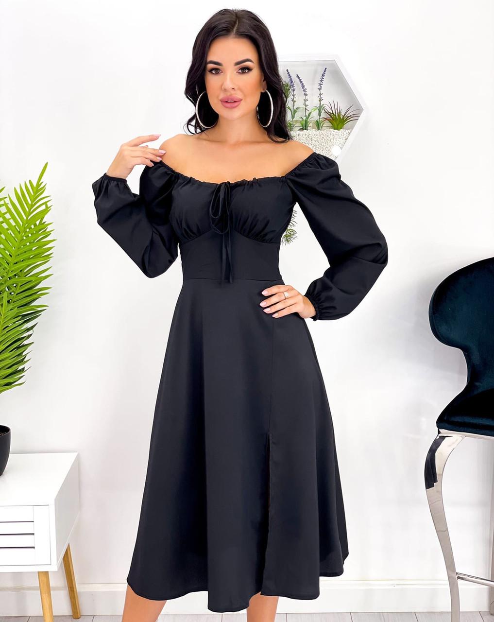 Приталене жіноче плаття міді з розрізом