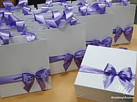 Подарочный бумажный пакет с лентой и бантом