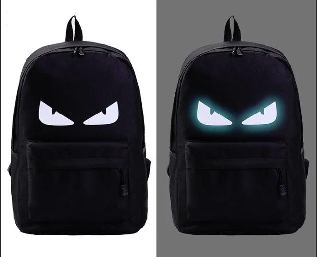 Шкільний рюкзак з ілюмінацією світиться в темряві принт.