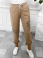 Стильні жіночі спортивні штани з Міккі Маусом, пояс з перестрочками, по низу манжет на гумці бежевий