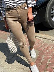 Обтягивающие женские джинсы с завышенной посадкой