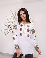 Красивая женская вышитая блуза из льна