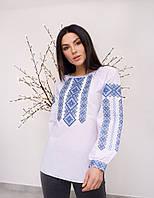 Красивая женская вышитая блуза с синим орнаментом