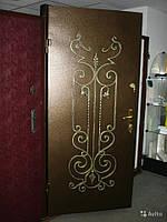 Входные тамрные двери металлические