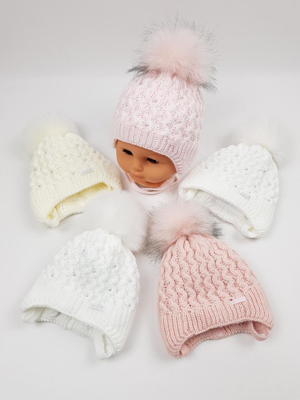 Дитячі польські зимові в'язані шапки на флісі з завязками і помпоном оптом для дівчат, р.36-38, Grans