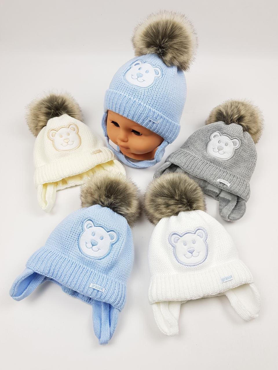 Дитячі польські зимові в'язані шапки на флісі з завязками і помпоном оптом для хлопців, р.38-40, Grans